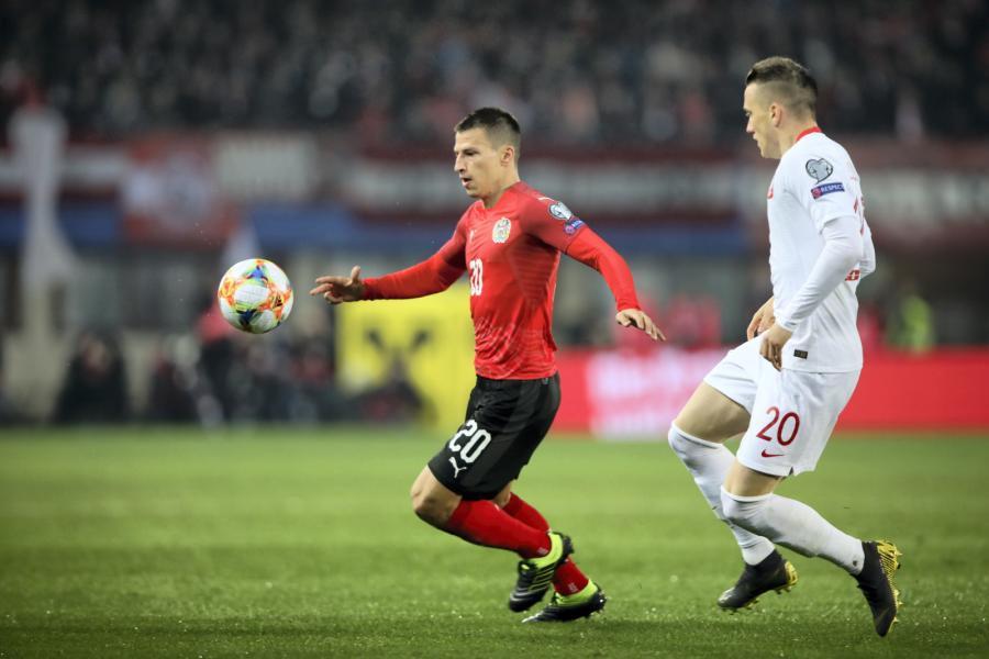 Piotr Zieliński (P) i Valentino Lazaro (L)