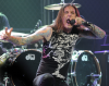 Tim Lambesis na scenie z As I Lay Dying